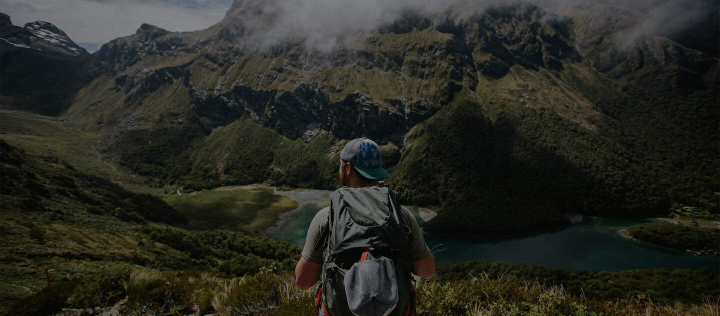 man looking out at the mountains in New Zealand
