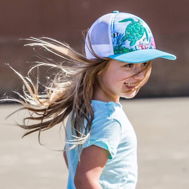 a06b47a689a Kids  Play Hat Kid wearing the Sea Turtle Trucker Cap