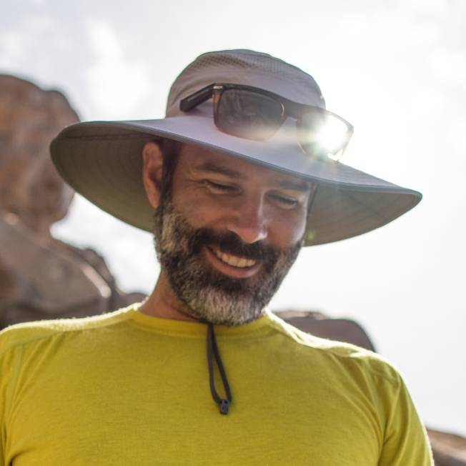 d329abf5a8eb5 Bearded man smiling and wearing the Latitude Hat